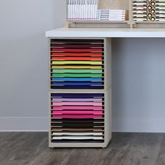 20 Smart Craft Organization Ideas for Making the Most out of Your Space - The Trending House Craft Room Desk, Craft Room Storage, Diy Desk, Craft Rooms, Diy Vinyl Storage, Storage Ideas, Craft Tables With Storage, Craft Room Tables, Stamp Storage