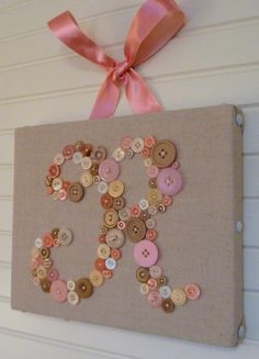 pink and brown buttons initial on burlap