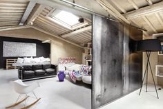 <I love industrial touches in homes like this sliding panel door>
