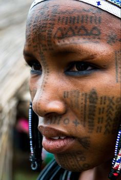 Africa | A Peul woman covered with facial tattoos. Photo taken in North Benin. | © Boaz Images