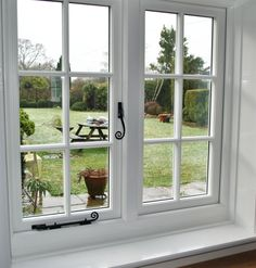 Cottage Style Windows maintain the look of traditional Georgian / Tudor timber windows and are built with state of the art Upvc Window technology inside. Timber Windows, Sash Windows, Casement Windows, Windows And Doors, Cottage Windows, Cottage Door, House Windows, Brick Cottage, Georgian Windows