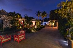The courtyard, with its pops of red at Hotel Taiwana in St. Barth