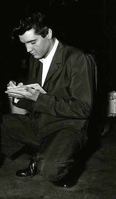 signing for a fan, Elvis Presley