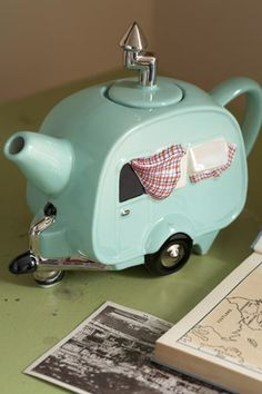 Vintage tea pot in the shape of a camper trailer. I just thinks its so cute.