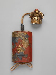 Case (Inrō ) with Design of a Gourd Vine,  Yasutada KOMA (Japanese), Edo period (1615–1868), 18th century, Case: gold, colored lacquer, gold leaf, and gold foil on red lacquer; (netsuke): ivory and lacquer carved in the shape of a Noh dancer, H. 9.2; W.6; D. 1.8 cm ©The Metropolitan Museum of Art #Inro, #Urushi, #Laque, #Japon, #Lacquer, #Japan