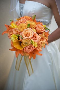 The Florist in me will never die.........Wedding bouquet shot October 2008. orange roses, lilies