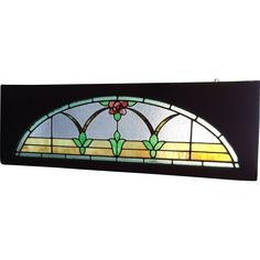 Large transom stained glass window featuring mission style rose  Original frame  Dimensions 83 wide x 21 1/2 high  Note minute hairline in clear textured glass and in green leaf Hardlyvisible