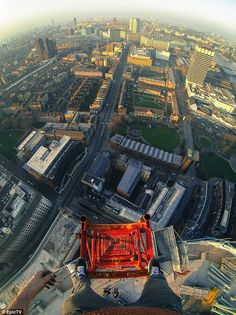 Long way down: James takes a snap across London with the Eye in view from the top of the t... JAMES KINGSTON