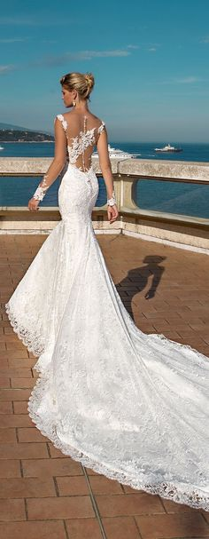mermaid wedding dress wtih long sheer sleeves and lace details and an open back