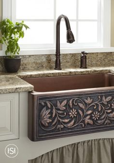 A deep well on the Vine Design Copper Farmhouse Sink makes it the perfect accompaniment to a gourmet kitchen. A lovely vine pattern on its apron brings a delightful accent to your counter.