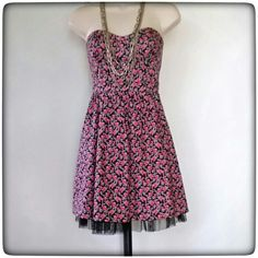 Black Poppy Strapless Dress Cute Summer floral dress 97% cotton,  3% spandex, with a 100% black tulle slip that shows a ruffle at the bottom. Hidden zipper in back.  Great condition. Black Poppy Dresses Strapless