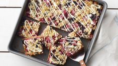 Sugar cookie mix does double duty in these summery bars forming the base and tasty crumble topping. We love that these bars are loaded with fresh raspberries and blueberries with a finishing touch of white chocolate drizzle to pull it all together.