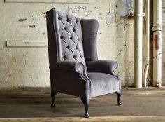 Modern British handmade Aldwick deep buttoned Chesterfield wing back Chair, shown Slate Naples velvet. High back and fixed cushion seat | Abode Sofas