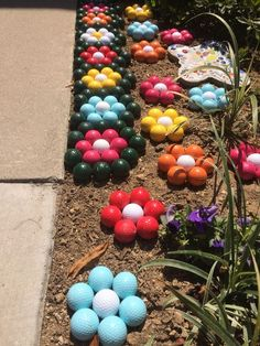 Cute golf ball flowers and lawn decoration for a golfer's home! More golf diy ideas at #lorisgolfshoppe