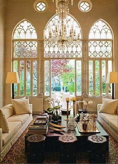 Cathedral style windows in a glamorous living room.