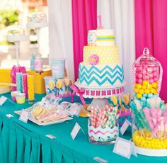 This colorful & modern pink, yellow & teal first birthday party features cotton candy favors, DIY zig zag streamer backdrop & more!