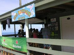 Hog Heaven for drinks, views before sunset and a light meal if you like (conch chowder, caribbean style BBQ pork). 2-3 miles uphill from Dos Sols on the road to Nail Bay. No reservations.