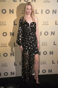 Striking: Nicole Kidman looked the picture of elegance as she attended the Paris premiere of new film Lion on Thursday, lighting up the red carpet at the Cinema Gaumont Opera