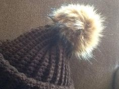 This soft and warm PomPom hat is great for the Canadian outdoors . Finished with a faux fur PomPom . One size fits most.