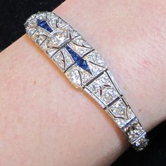 An elegant and understated platinum Art Deco sapphire and diamond bracelet set with 2.85ct of diamonds, highlighted with French cut blue sapphires. www.rutherford.com.au