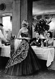 Modeling an evening dress by Carven at Taillevent, Paris, 1960. Photo: Philippe Pottier.