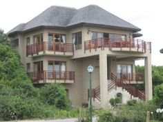 Multi-story home in a sought-after beach front access controlled estate. Open beams and thatch are distinctive features of this unique home. Offers spacious, free flowing living areas and balconies with sea views. Adjacent vacant stand included. Additional advantage of a private boardwalk to the unspoiled Wilderness beach.