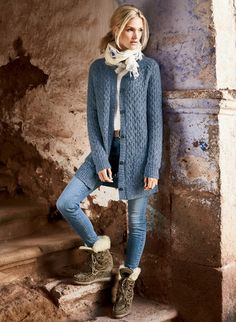 The Aster Blue cardigan is knit in a textural honeycomb of frothy baby alpaca (49%), nylon (29%), pima (18%) and wool (4%). Saddle shoulders; patch pockets.