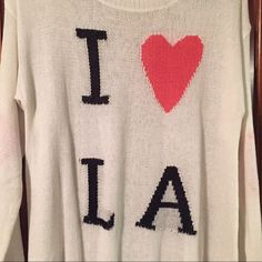 White ' I ❤️ LA ' sweater Long sleeve white 'I ❤️ LA' sweater. size S/M  oversize & comfy. Only worn once! Great condition. Sweaters Crew & Scoop Necks