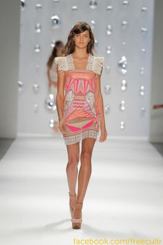 Custo Barcelona Spring 2013 Collection at New York Fashion Week was just fit for celebs like Katy Perry and Rihanna! Tees with girly faces and man totes, the show extended an affection towards fusion fashion. #NYFW