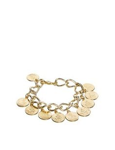 Cool Coin Jewelry For Summer:  Adele Marie Chunky Coin Charm Bracelet. Sure, you can mix it in with other bracelets, but it's definitely cool enough to stand on its own, too.