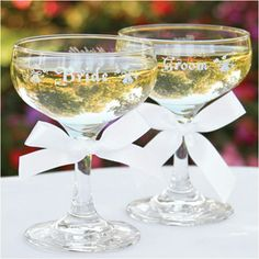"Toasting Flutes - Champagne Toasting Glasses - WeddingDepot.com - 030-86716 Celebrate your wedding toast with this set of Champagne Toasting Glasses.  Each glass measures 4.5"" tall and hold 5.5 ounces of Champagne or your favorite toasting beverage.  Each glass comes with ""Bride"" and ""Groom"" along with wedding bells printed in white."