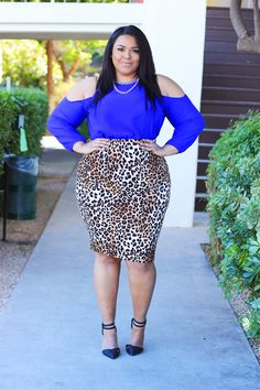 Style blogger Nicole from the fashion blog Curves On A Budget spotted in Fashion To Figure's Campbell Leopard Midi Skirt $22.99 | Spotted and ruched, the Campbell plus size skirt features a wild leopard print and comfy stretch fit. Pair with a perfect-match top for roar-worthy style.