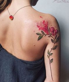 This watercolor blooming flower tattoo is simple and stunning. This is a super cool placement idea too!