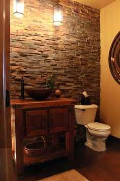 Rustic, reclaimed barnwood bathroom vanity with copper vessel sink. Stone floor to ceiling tile. We are a high end furniture store & have a talented staff of interior designers.