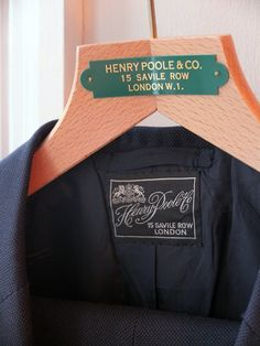 Navy birdseye suit from Henry Poole of Savile Row. Even the damn label is beautiful! #menswear