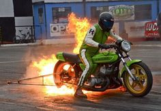 STRANGE DRAG BIKE BURNOUT - BIG FLAMES - RACING MOTORCYCLE WITH WHEELIE BAR PREPARES FOR RACE