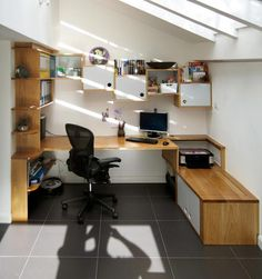 Home / /Office in Oak with grey lacquered cabinet fronts.