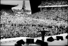 Oasis (Noel Gallagher) at Maine Road in Manchester, England, 1996. Photographed by Jill Furmanovsky.