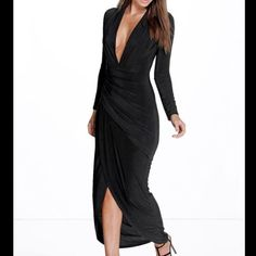 """From the """"Booboo Night"""" line this slinky and sexy floor-length gown has a thigh high split, deep v plunging neckline, faux wrap ruched detail around the waist, and long sleeves. It's a shiny jersey material that is stretchy and flattering. Brand new and never worn! The dress is a U.S. size 12 and a U.K. size 16."""