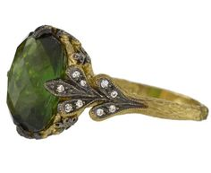 Cathy Waterman. I prefer vintage jewelry because I think it is more ethical, but I love the look of this.
