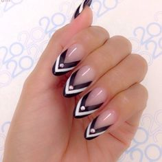 Nude almond nails with black and white Chevron tips.