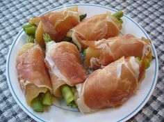 Chicken and asparagus roll ups before slow cooking ~ PaleoPot