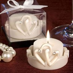 Interlocking Hearts Design Favor Saver Candles. Contemporary and elegant design makes these wedding favors a great choice!  http://www.favorfavor.com/page/FF/PROD/8304