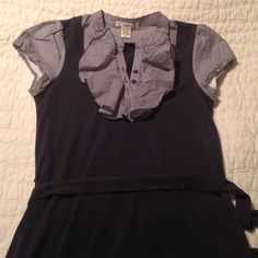 Cute professional top Comfort and style, this top is perfect! Feels like a tee shirt! Worn only a handful of times. Some pilling on back corner from wearing a purse (pictured). Fit is junior-sized, so it fits more like a women's small. Tops Blouses