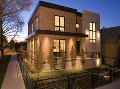 Exterior, : Beautiful Minimalist Home Exterior Design Idea With Brown Brick Wall Designed With Roof Less Plus Black Iron Fence And Small Garden Also Great Lighting Design