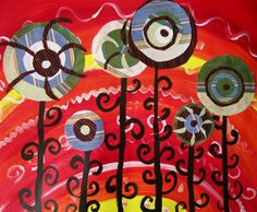 Hundertwasser lesson - create backgrounds with warm colors - paint black stems and then add fabric circles.