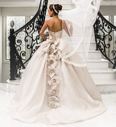 Sequin ball gown wedding dress with a v-neckline and floral accents. Beautiful dress in perfect condition!