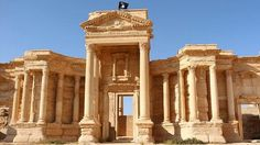 An image allegedly showing a flag of the Islamic State (IS) group flying above a Roman theatre in th... - AFP
