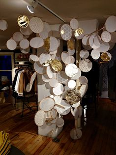 Philadelphia Anthropologie flagship store's 2015 holiday decor included these shining embroidery hoops filled with metallic papers. See more of the store's displays and windows on the blog.