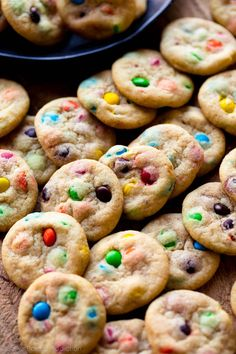 Adorable and bite-sized mini M&M cookies! Cookie recipe on sallysbakingaddiction.com